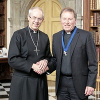 Former Dean of Belfast John Mann receives award for ecumenism