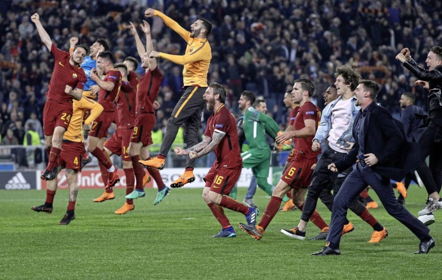 Roma players celebrate reaching the semi-finals of the Champions League after a 3-0 second leg win over Barcelona