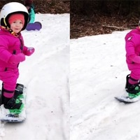 This cute toddler is already an impressive snowboarder at the age of two