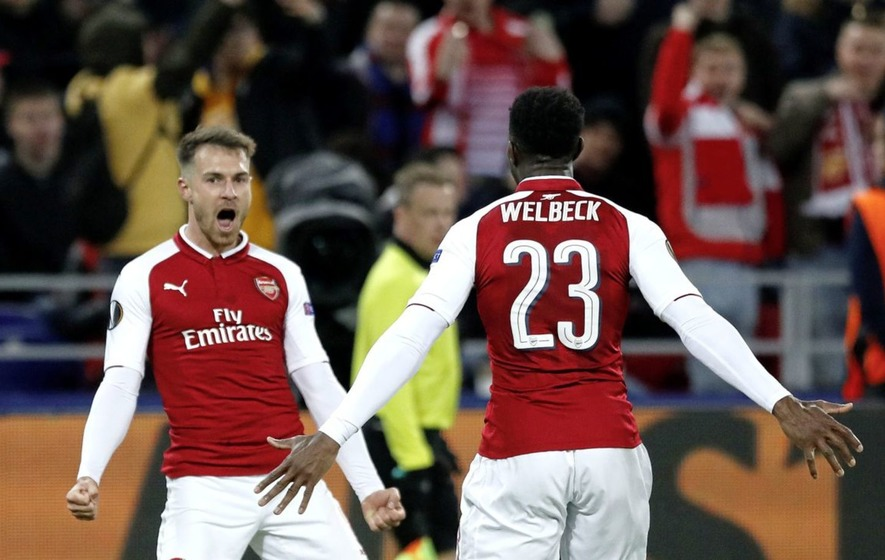 Arsenal's Aaron Ramsey left celebrates with Danny Welbeck after scoring his side's second goal in the 2-2 draw with CSKA Moscow