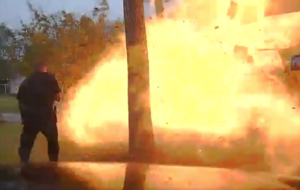 Watch the shocking moment a house exploded as police officers approached