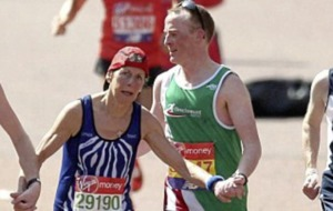 West Belfast runner Mark Carey goes the extra mile to help fellow marathon runner