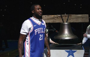 Rapper Meek Mill celebrates prison release with visit to NBA play-off