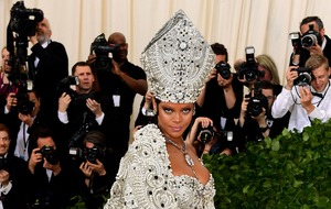 Rihanna reigns over the Met Gala in stunning Pope dress