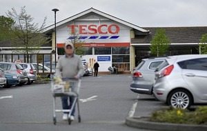 Tesco grows share of north's grocery market after rivals announce merger deal