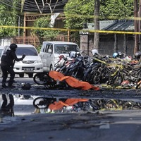 At least 13 people killed in suicide attacks on Indonesian churches