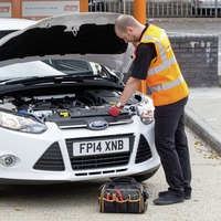 Halfords profits dip on currency hit