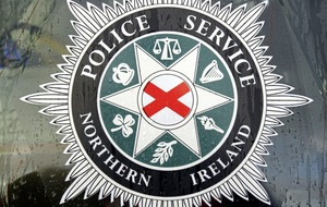 Two arrested as firearms found in west Belfast