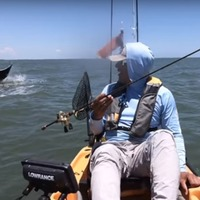 Watch this massive ray surprise a fisherman by leaping out of the water twice
