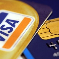 Visa operating at 'full capacity' as firm apologises for system failure