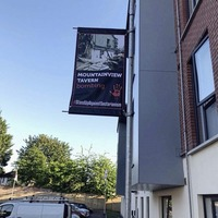Banners depicting IRA attacks should be removed from shared housing estate, housing chief says