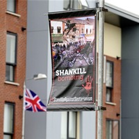 Calls for banners to be removed from shared housing estates