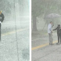 Why was this officer smiling in the middle of the road in the pouring rain?