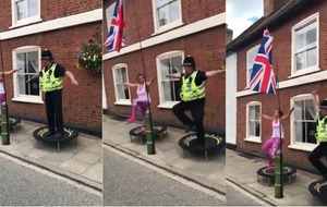 If you've never seen a policeman exercising on a trampoline, here's your chance