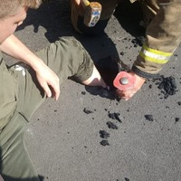 It's so hot this man got his leg stuck in melted tarmac