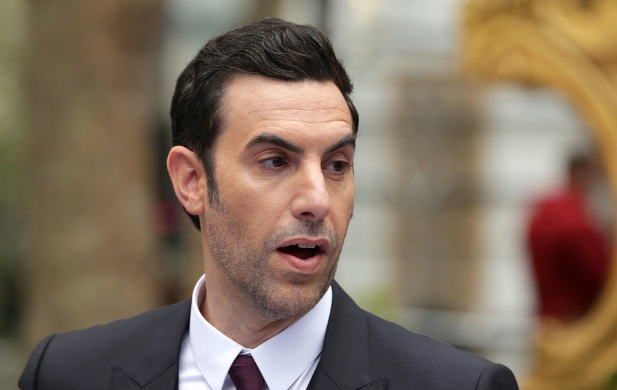 Sacha Baron Cohen teases project with Dick Cheney signing 'waterboard kit'