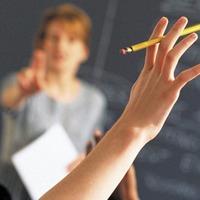 A-level grades should be considered alongside students' background - watchdog