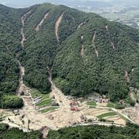 PM Shinzo Abe visits flood-hit western Japan as deaths reaches 176