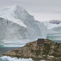Four-mile-long iceberg breaks off from Greenland glacier