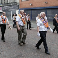 Orangeman John Aughey, jailed for driving into crowd in Ardoyne, joins marchers at main Belfast parade