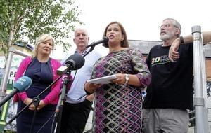 Sinn Féin 'will not be intimidated' leader tells west Belfast rally following attack on homes of Adams and Storey