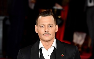 Johnny Depp settles lawsuit with former managers a month before trial