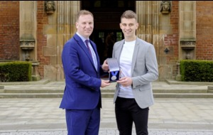 Shea Heffron honoured to receive prestigious Cormac McAnallen Medal for his contribution to Queen's GAC