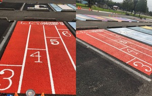 Seniors at Louisiana high school paint school parking spots into custom murals