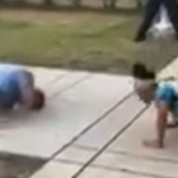 Police officer drops to the floor in community press-up contest