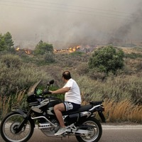 Residents flee homes as Athens forest fire rages out of control