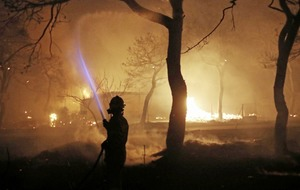 At least 50 killed as wildfires rage through Greece