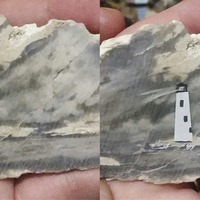 This grey rock provided an artist with a perfect backdrop for her tiny painting