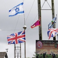 Israeli flags flown close to site of social housing development previously bedecked with UVF flags