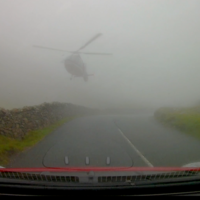 Watch: A helicopter emerges out of the mist on Lake District road