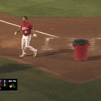 An angry baseball player took a bin on the field and told the umpire to get in