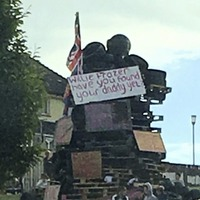 Condemnation of Newry anti-internment bonfire with sign mocking Willie Frazer's murdered father