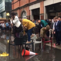 Watch: Londoners make bridge of chairs amid flooding at Hammersmith station