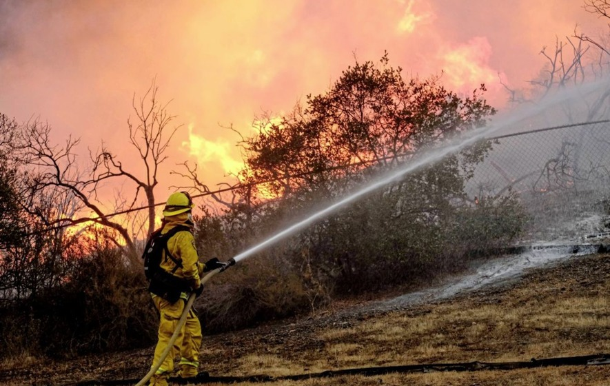 Intentionally set wildfire gets perilously close to homes in