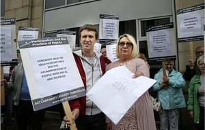 Mum protests at department's Belfast offices over benefits decision