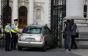 Woman arrested after car crashes into Dublin's Government Buildings