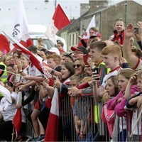 Crowds cheer home Tyrone GAA squad after All-Ireland final