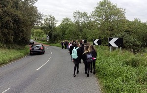 Parents protest at withdrawal of bus passes for children on 'unsafe' rural road