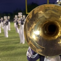 Marching band member goes viral playing perfect air drums during NFL game
