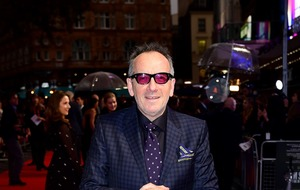 Singer Elvis Costello 'right as rain' after cancer op