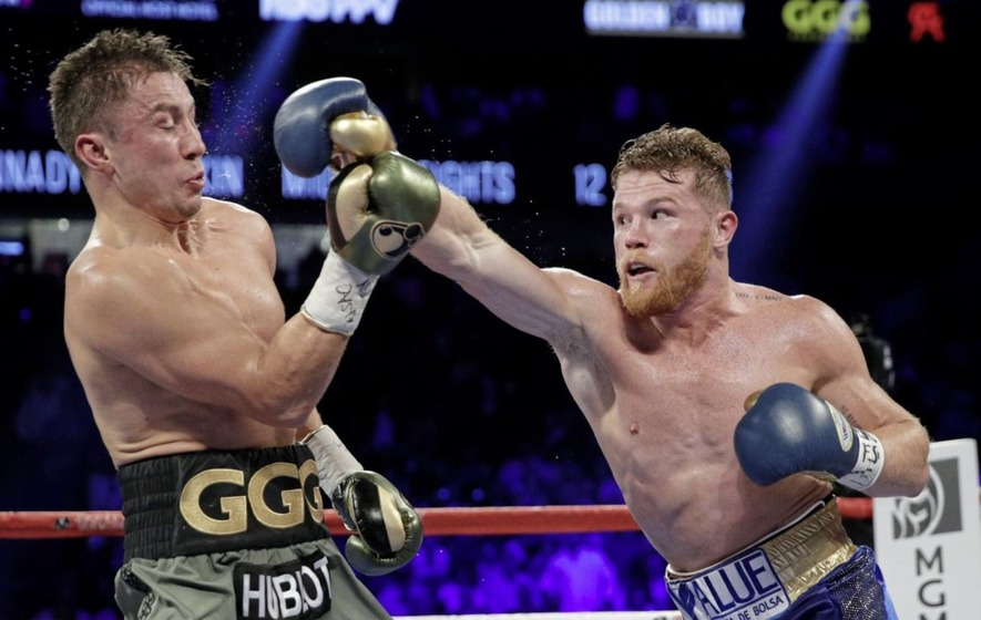 Gennady Golovkin slips a right hand from 'Canelo&#39 Alvarez during their first meeting