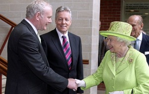 Queen Elizabeth says it would have been awkward not to shake Martin McGuinness's hand