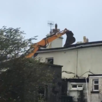 Watch: JCB stops neighbour's roof flying away during Storm Ali