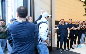 iPhone fans hit Apple Stores as latest handsets go on sale
