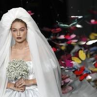 Gigi Hadid wears mini puffball bridal gown at star-studded Moschino show