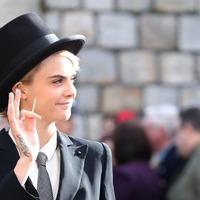 Cara Delevingne wears bold top hat and tails to the royal wedding